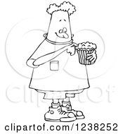 Clipart Of A Black And White Boy Eating A Cupcake Royalty Free Vector Illustration