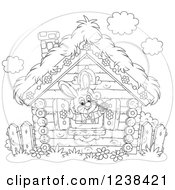 Clipart Of A Black And White Bunny Rabbit In A Log Cabin Window Royalty Free Vector Illustration by Alex Bannykh