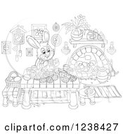 Clipart Of A Black And White Rabbit Painting Easter Eggs On A Table Royalty Free Vector Illustration
