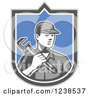 Clipart Of A Retro Woodcut Plumber Holding A Monkey Wrench In A Shield Royalty Free Vector Illustration