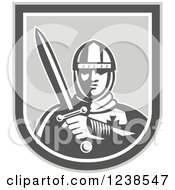 Clipart Of A Retro Knight Holding A Sword In A Shield Royalty Free Vector Illustration