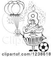 Black And White Boys Eighth Birthday Cupcake With A Soccer Ball And Balloons