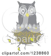 Clipart Of An Owl With Chicks In A Nest Royalty Free Vector Illustration