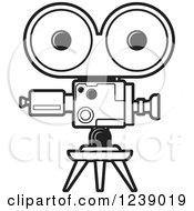 Clipart Of A Black And White Movie Camera Royalty Free Vector Illustration by Lal Perera