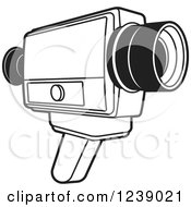 Clipart Of A Black And White Video Camera Royalty Free Vector Illustration