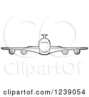 Clipart Of A Black And White Commercial Airliner Plane Royalty Free Vector Illustration by Lal Perera