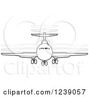 Clipart Of A Black And White Commercial Airliner Plane With Movement Trails 2 Royalty Free Vector Illustration by Lal Perera