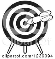 Clipart Of A Black And White Dart In A Target Royalty Free Vector Illustration by Lal Perera