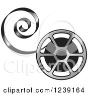 Clipart Of A Silver Film Reel With Curling Tape Royalty Free Vector Illustration by Lal Perera