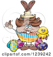 Clipart Of A Black Easter Bunny Cupcake With A Chick And Eggs Royalty Free Vector Illustration