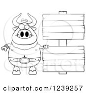 Clipart Of A Black And WhiteHappy Minotaur Bull Man With Wood Signs Royalty Free Vector Illustration by Cory Thoman