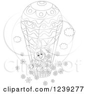 Clipart Of A Black And White Easter Bunny Rabbit On An Egg Hot Air Balloon With Flowers Royalty Free Vector Illustration by Alex Bannykh