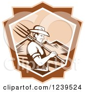 Clipart Of A Retro Woodcut Male Farmer With A Pitchfork And Mountains In A Shield Royalty Free Vector Illustration