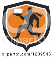 Clipart Of A Silhoutted Computer Repair Man Running With A Laptop In An Orange Shield Royalty Free Vector Illustration