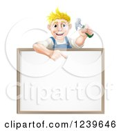 Happy Blond Worker Man Holding A Hammer And Pointing Down At A White Board Sign