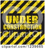 Clipart Of Distressed Under Construction Text With Diagonal Hazard Stripes Royalty Free Vector Illustration by KJ Pargeter