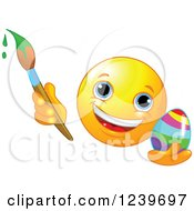 Clipart Of A Happy Smiley Emoticon Painting An Easter Egg Royalty Free Vector Illustration