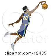 Male African American Basketball Athlete Jumping With The Ball