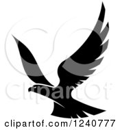 Clipart Of A Black And White Eagle In Flight 4 Royalty Free Vector Illustration