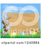 Clipart Of A Wood Sign With A Brown Easter Bunny Eggs Grass And Sky Royalty Free Vector Illustration by AtStockIllustration