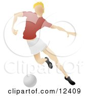 Blond Male Soccer Player Kicking A Ball During A Game