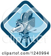 Clipart Of A Retro Blue Movie Camera In A Diamond Royalty Free Vector Illustration