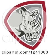 Clipart Of A Retro Rhino In A Gray And Maroon Shield Royalty Free Vector Illustration by patrimonio
