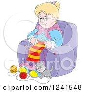 Happy Blond Granny Knitting While A Kitten Plays With Yarn