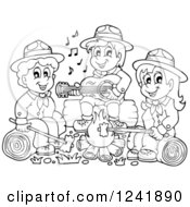 Clipart Of Black And White Boy And Girl Scouts Singing Around A Camp Fire Royalty Free Vector Illustration by visekart