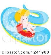 Happy Caucasian Boy Tubing Down A Waterslide