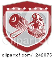 Clipart Of A Retro Shield With A Dumbbell And Sledgehammer Royalty Free Vector Illustration