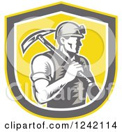 Retro Woodcut Male Miner Worker With A Pickaxe In A Yellow Shield