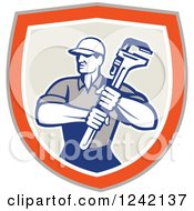 Clipart Of A Retro Male Plumber Holding A Monkey Wrench In A Shield Royalty Free Vector Illustration