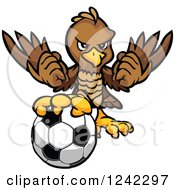 Clipart Of A Brown Falcon Sports Mascot With A Soccer Ball Royalty Free Vector Illustration by Chromaco