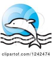 Clipart Of A Leaping Dolphin And Waves Over A Blue Circle Royalty Free Vector Illustration by Lal Perera