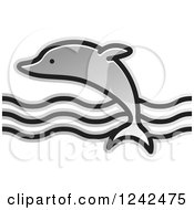 Clipart Of A Silver Leaping Dolphin And Waves Royalty Free Vector Illustration by Lal Perera
