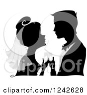 Clipart Of A Silhouetted Bride And Groom With Champagne During The Wedding Toast Royalty Free Vector Illustration