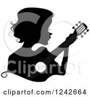 Clipart Of A Black Silhouetted Woman Playing A Guitar Royalty Free Vector Illustration