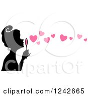Clipart Of A Black Silhouetted Woman Blowing Pink Heart Bubbles Royalty Free Vector Illustration