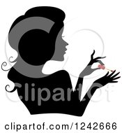 Clipart Of A Black Silhouetted Woman Painting Her Nails Red Royalty Free Vector Illustration