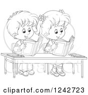 Clipart Of Black And White School Children Reading At Their Desk Royalty Free Vector Illustration