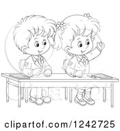 Clipart Of Black And White School Children At Their Desk Royalty Free Vector Illustration