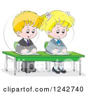 Blond School Children Writing At Their Desk