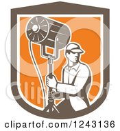 Clipart Of A Retro Male Stage Worker Moving A Lighting Stand In A Shield Royalty Free Vector Illustration by patrimonio