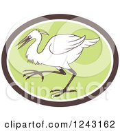 Clipart Of A Retro Egret Heron Or Crane Bird In A Green Oval Royalty Free Vector Illustration