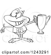 Clipart Of A Black And White Cartoon Winner Frog Holding Up A Trophy Royalty Free Vector Illustration