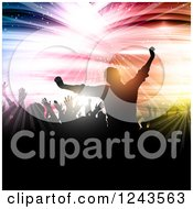 Silhouetted Cheering Crowd Over Colorful Shooting Lights