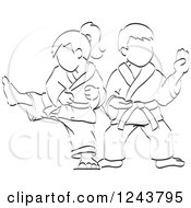 Clipart Of A Black And White Sketched Boy And Girl Doing Karate Moves Royalty Free Vector Illustration