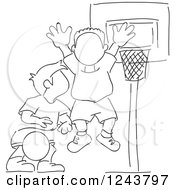 Clipart Of Black And White Sketched Boys Playing Basketball Royalty Free Vector Illustration