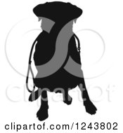Black Silhouetted Labrador Retriever Dog Sitting With A Leash